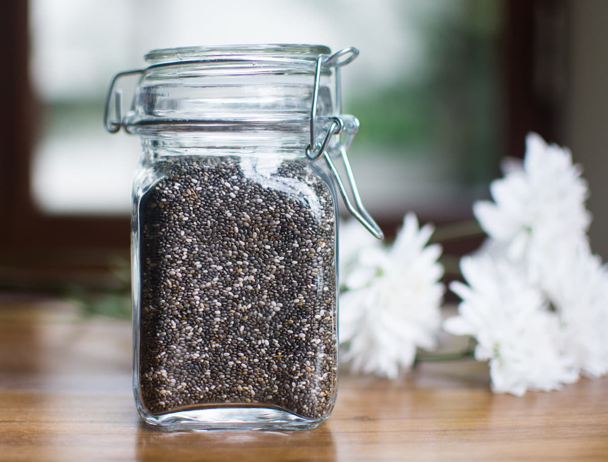 Chia Seeds in a glass jar with flowers